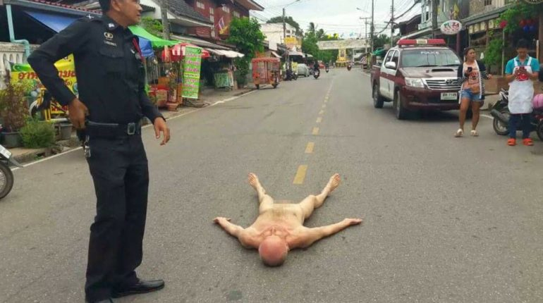 The naked Frenchman lying naked in the road in Prachuap Khiri Khan