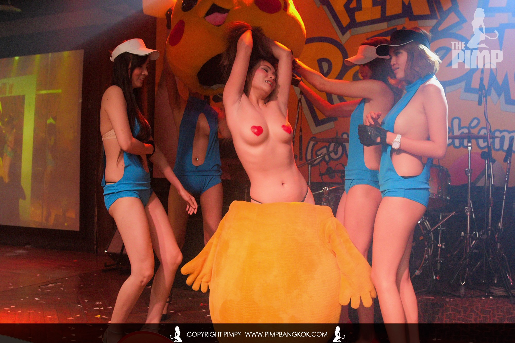 A sexy gogo girl sprints out of a Pikachu costume at a Pokemon party in Bangkok
