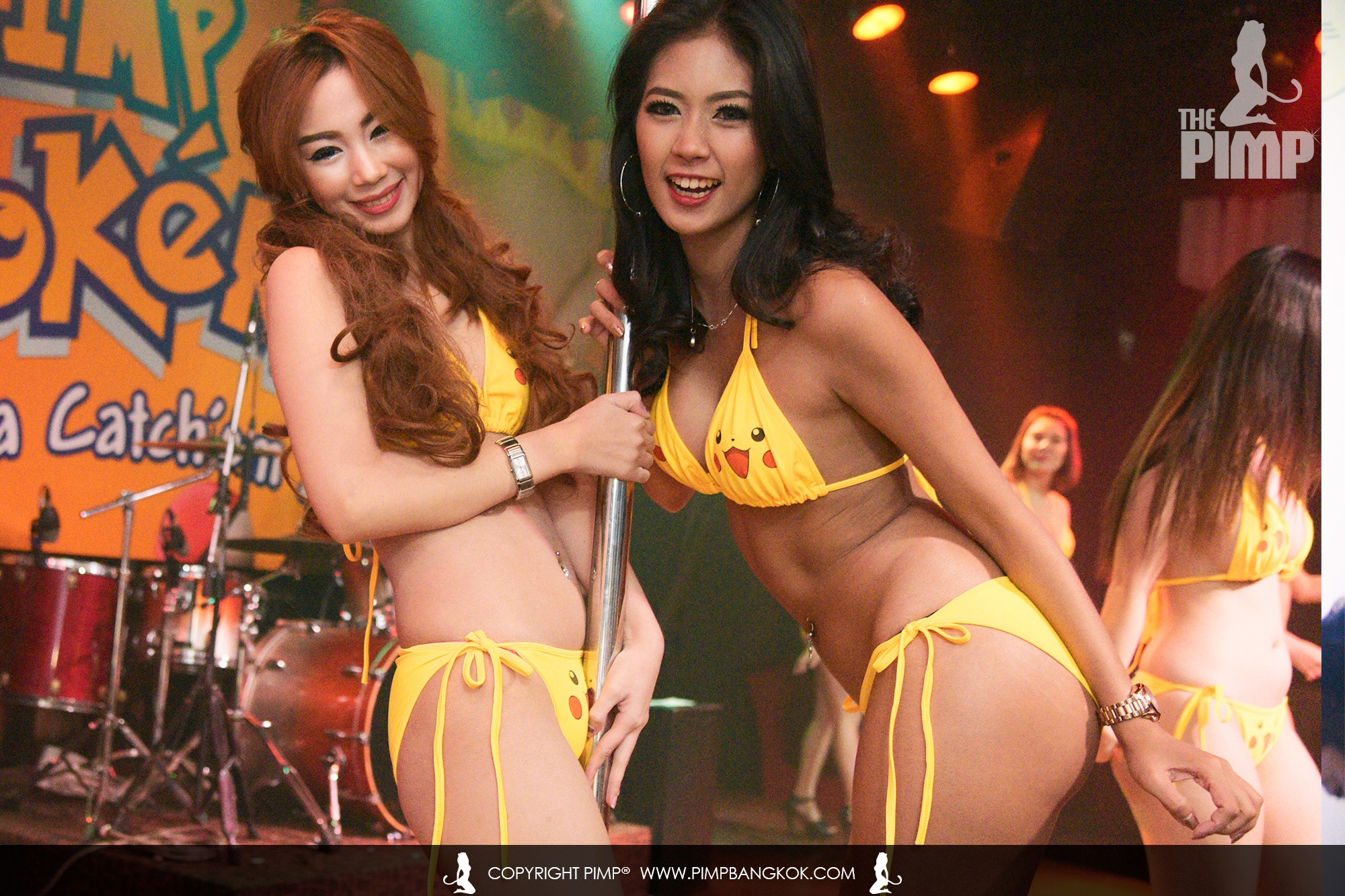 Two of the dancers from The PIMP club in their yellow Pikachu bikinis