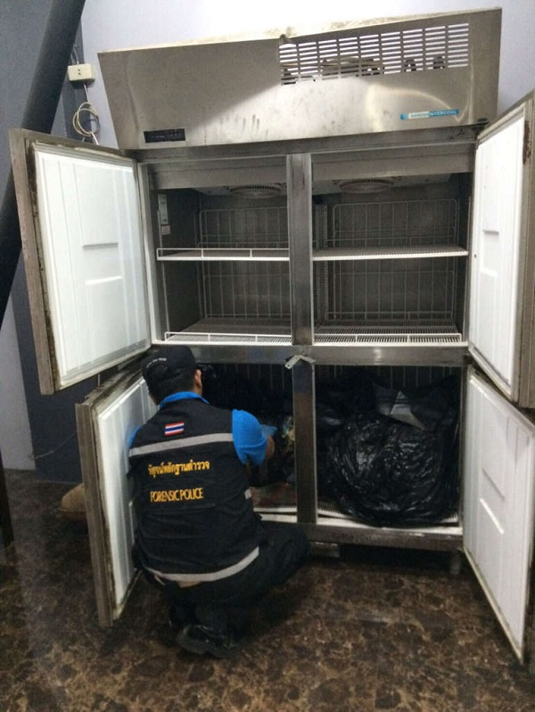 Police find the chopped up body in the fridge after the raid on the fake passport gang