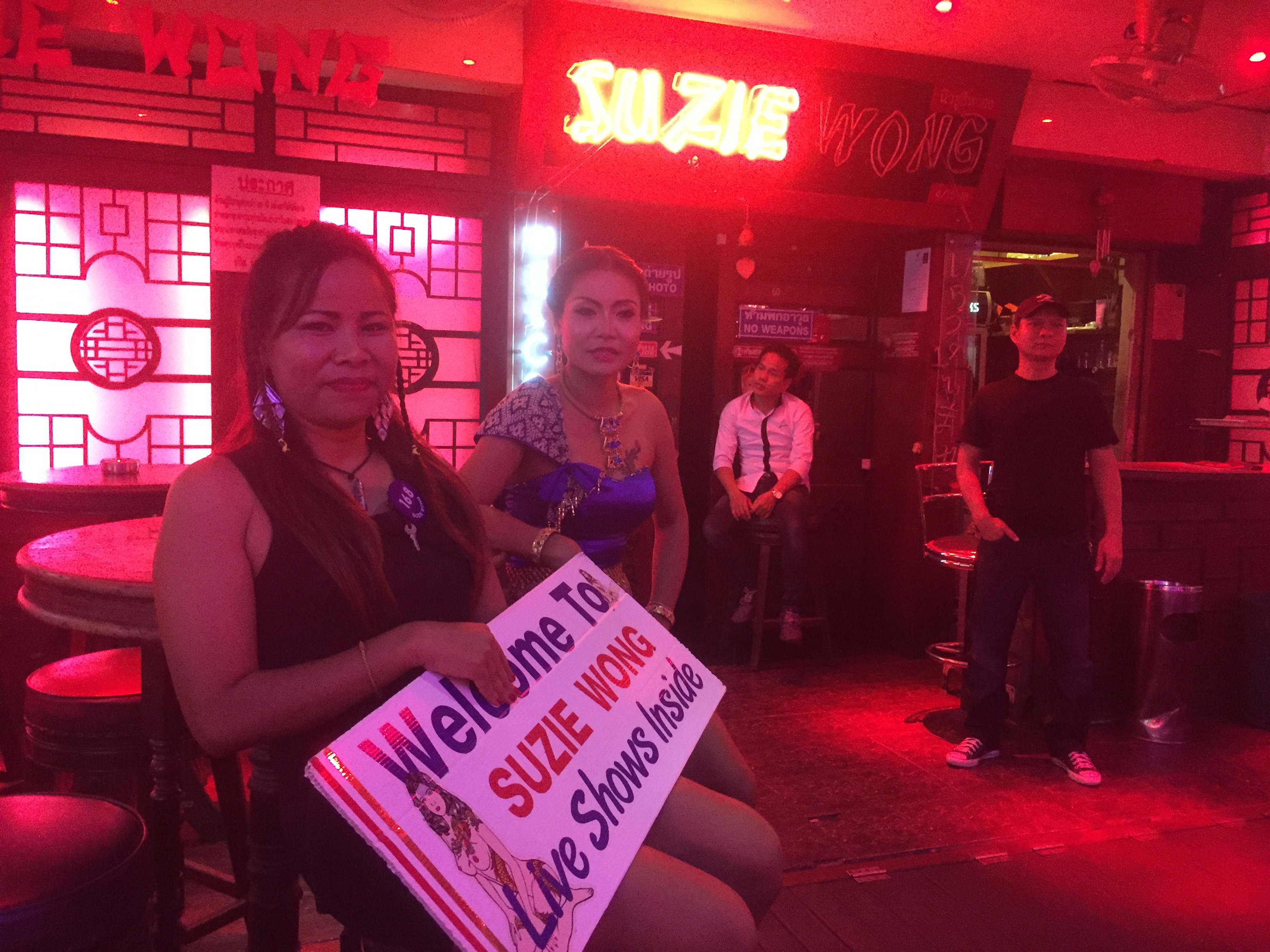 Girls outside Suzie Wong bar on Soi Cowboy a month after the Thai king died