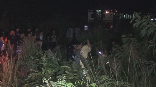 Locals gather at the scene of the accident