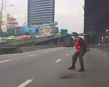 cop almost killed directing traffic in Bangkok Thailand