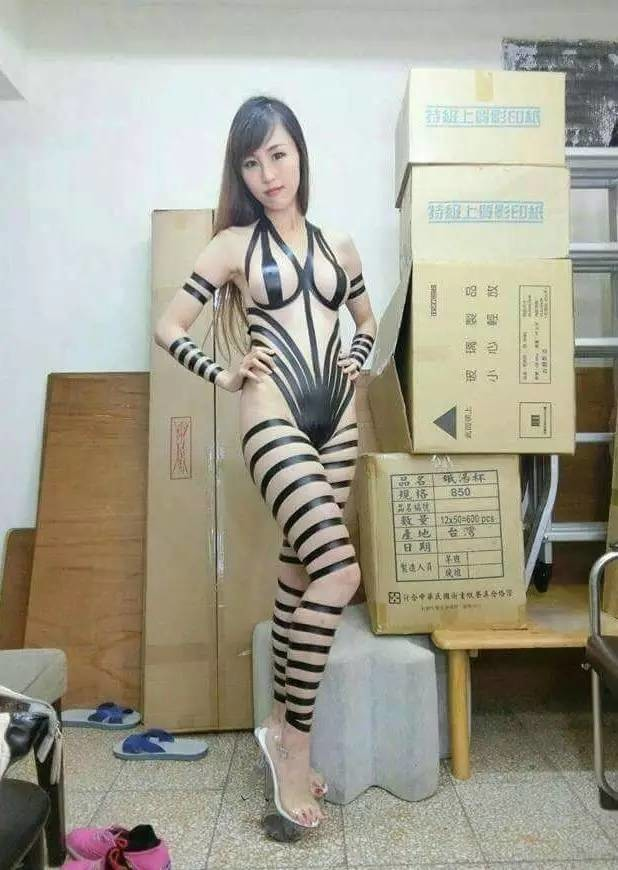 The Chinese girl with her sticky tape swimsuit