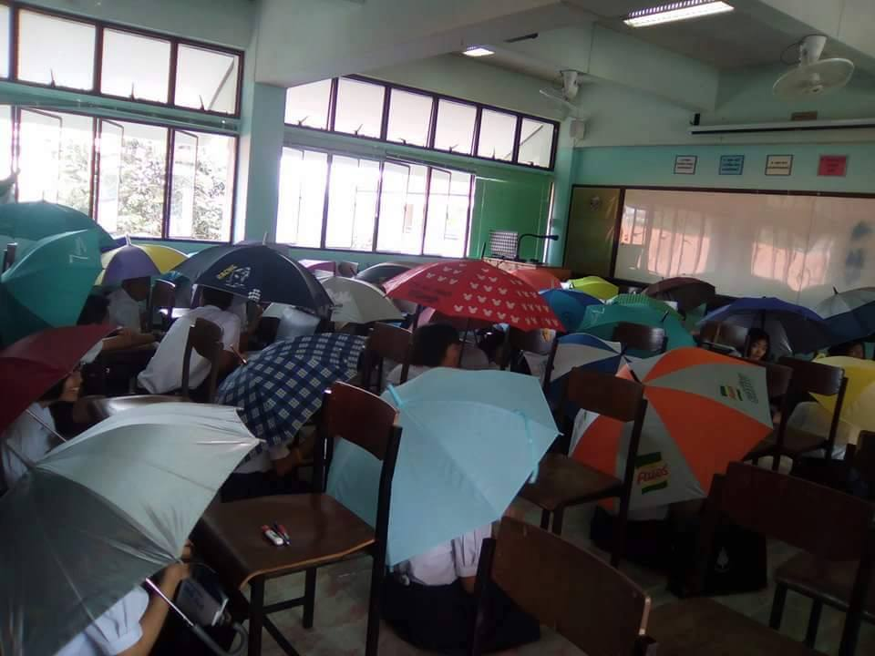 The school said students holding umbrellas in tests wasn't an official policy but the teacher was pleased with his plan
