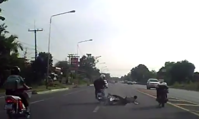 Motorbike gang chase teenager and knock him off his bike