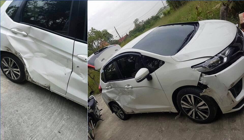 The damage to the white Honda Jazz after the road rage chase in Bangkok