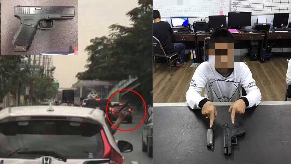 The driver, right, hands himself in to police with his weapon