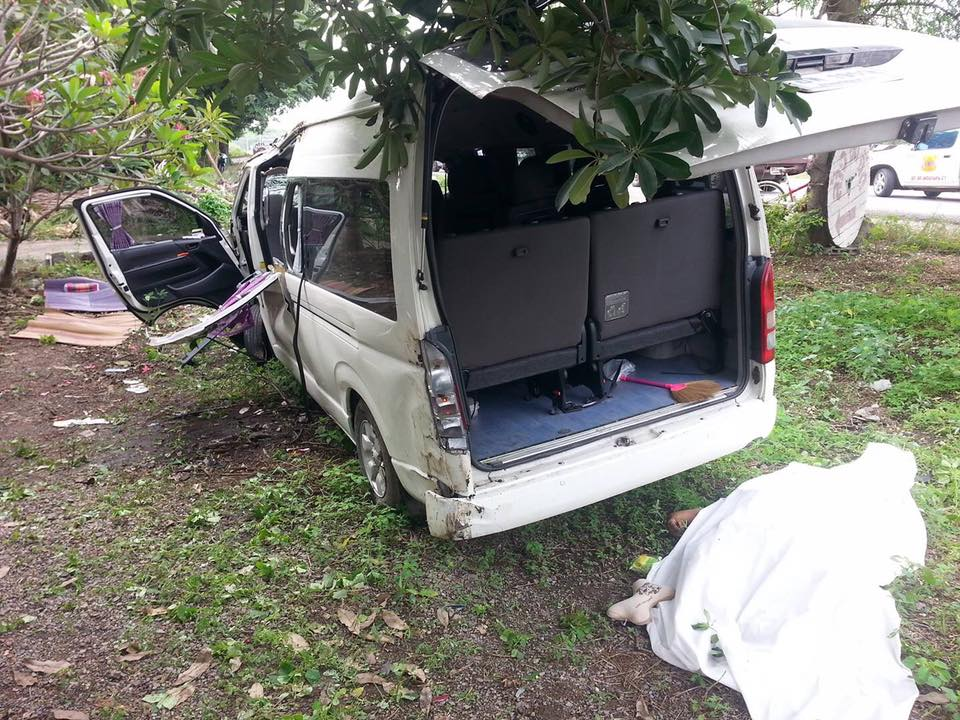 The white mini van bus after it was shunted off the road in Lopburi
