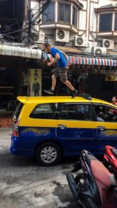 Tourist running over taxi roof in Pattaya