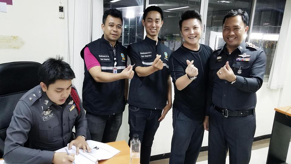 Jerry Liu, 32, jokes with Thai police after the incident