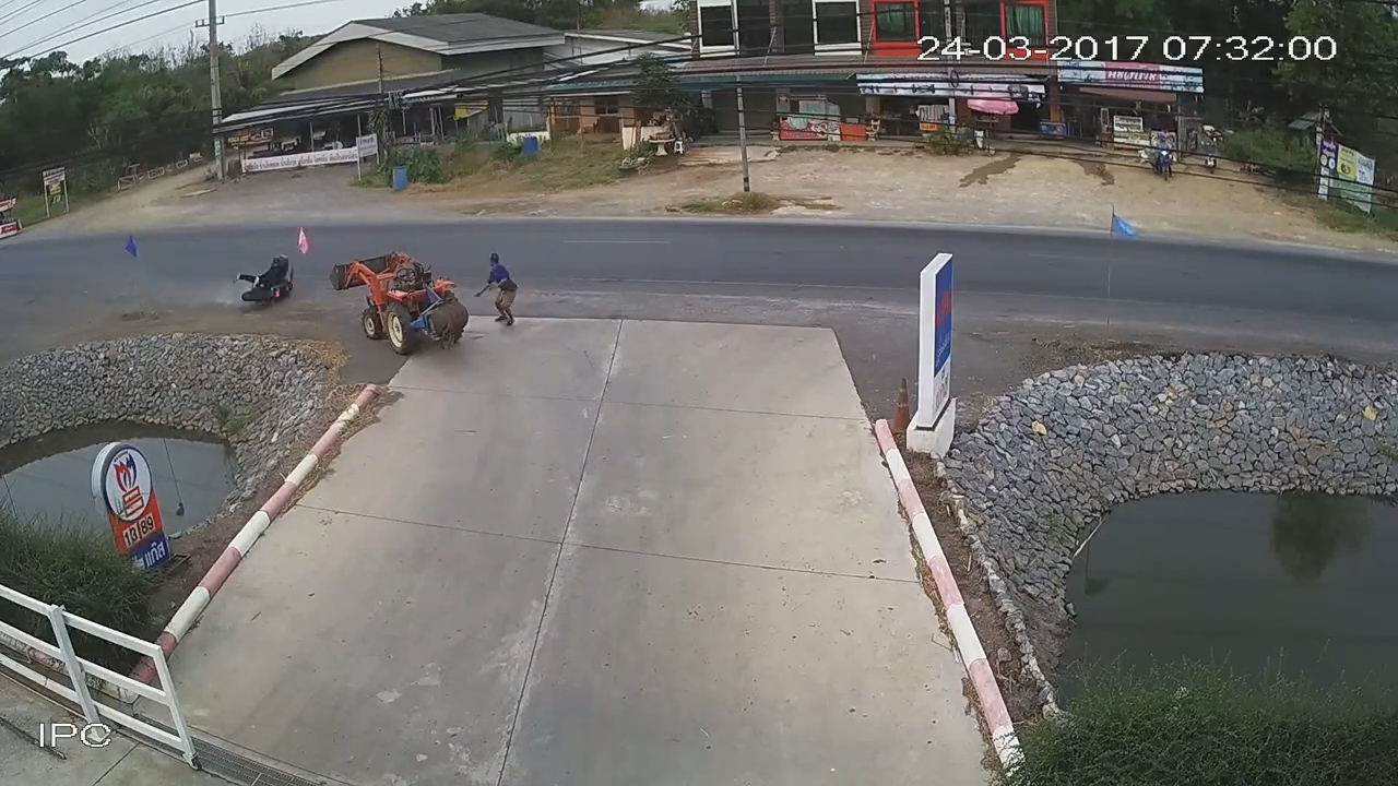 The man runs away from the motorbike as it skids towards him