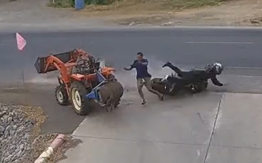 FARMER JUMPS OUT OF THE WAY OF SKIDDIG MOTORBIKE CRASH