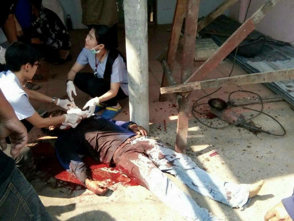Suwan Ladee , 54, lies dead on the ground after being killed by an electric saw in a freak accident