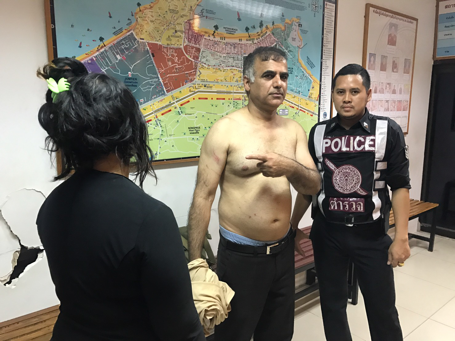 Talebi Esfahani, 55, with police after hookers stole 40,000THB