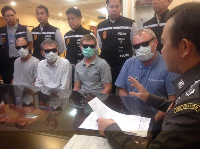 Russian mafia wearing sunglasses and surgical masks after being arrested