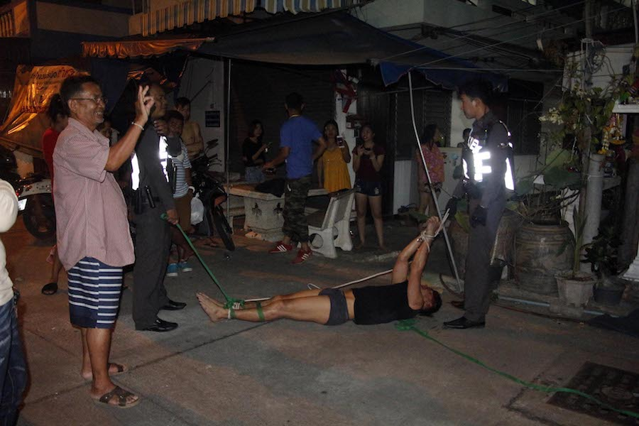 British tourist is tied up his pants by angry locals in PattayaBritish tourist is tied up his pants by angry locals in Pattaya