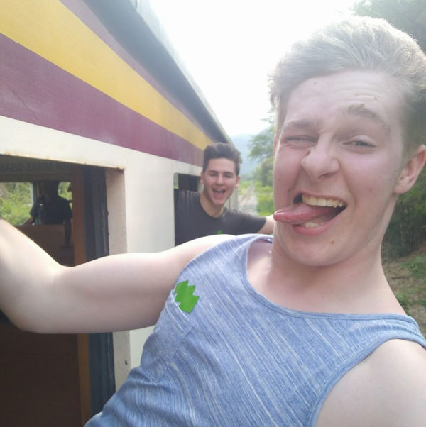 Daniel Clark, 20, takes a reckless selfie hanging from a train window three days before he fell from a carriage