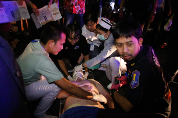Paramedics try to revive Christopher after he fell from a window above Sweetheart Agogo in Pattaya