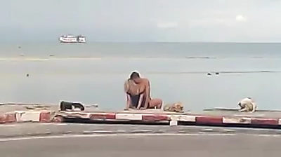 Two tourists filmed romping on the beach at Ko Samui this morning