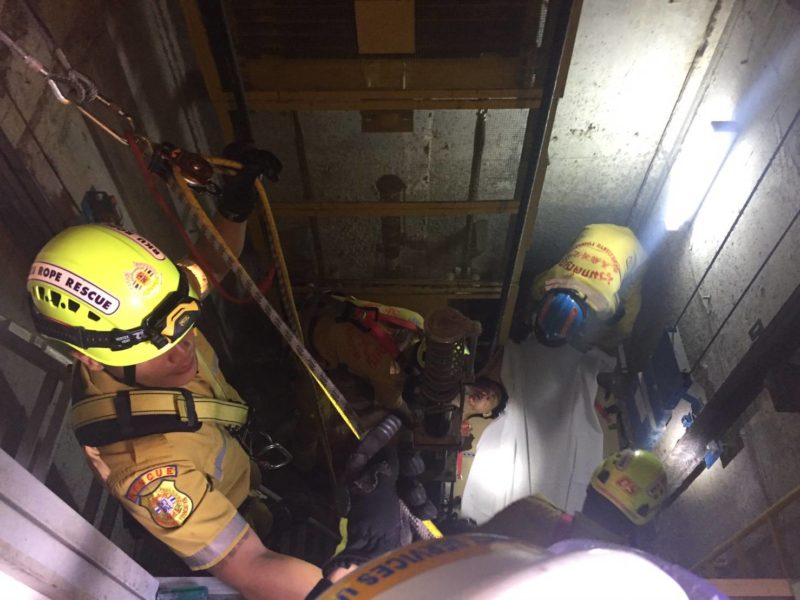 Korean tourist Doo Ho Lee, 33, is pulled out of the lift shaft at the bloc of condos in Bangkok