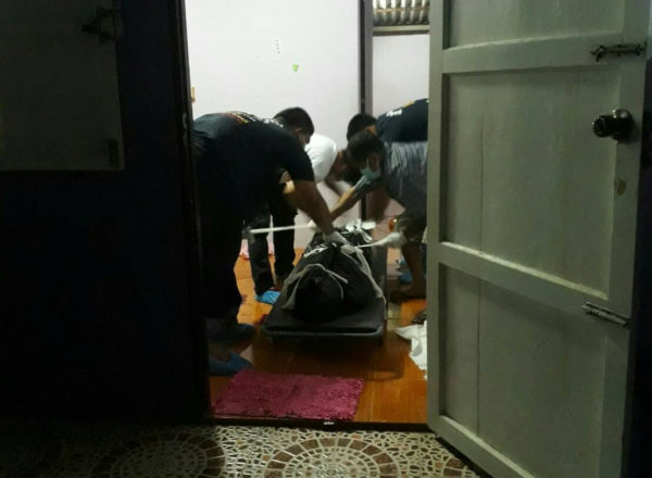 Police remove the body from the motel in Prachuap Khiri Khan, southern Thailand