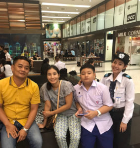 June and her proud parents in Pathum Thani