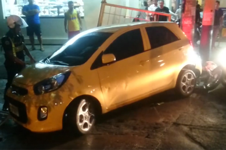 The yellow Kia after the road rage in Manila, Philippines