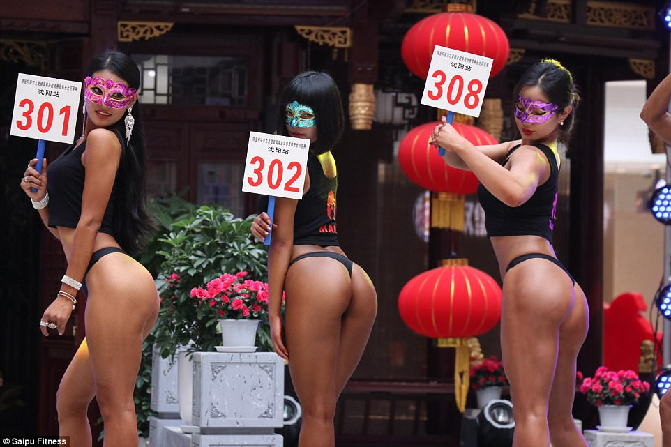 Gao Qian in the centre number 302 with other contestants at the 'most beautiful buttocks' contest in Shenyang, China, on June 24