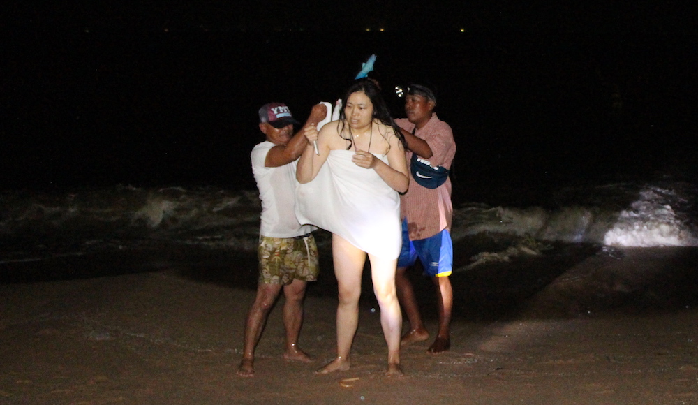 Naked Chinese tourist in Pattaya after she went skinny dipping on Jomtien Beach