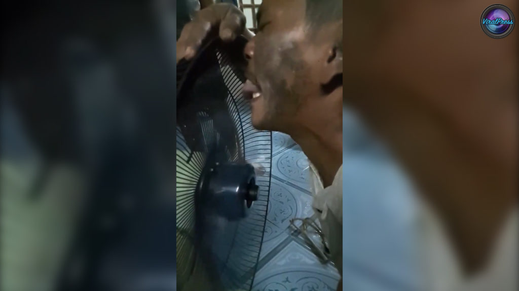 thai man stops a moving fan with his tongue