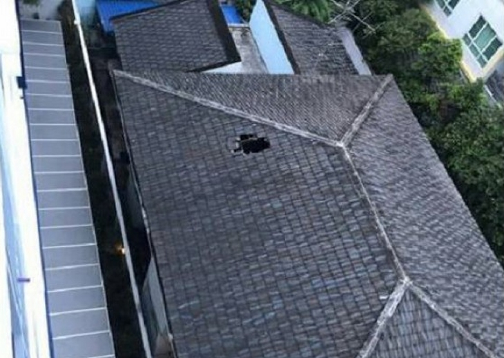 The hole in the top of the house left by the man who appeared to have committed suicide