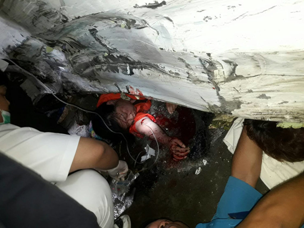One of the passengers is trapped in the wreckage of the Phuket bus crash