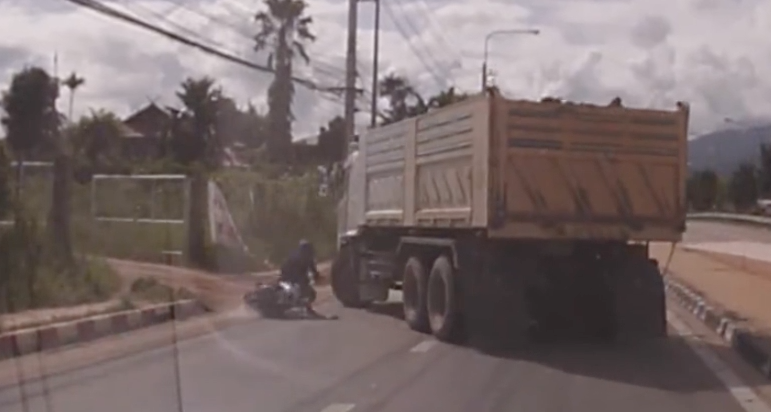 Motorcycle Rider Falls Under Truck And SURVIVES