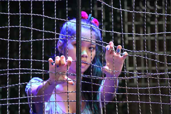 The girl inside the cage in the water dunking game on Pattaya Walking Street