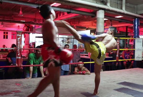 Two kids Muay Thai boxing in a beer bar complex on Beach Road, in Pattaya