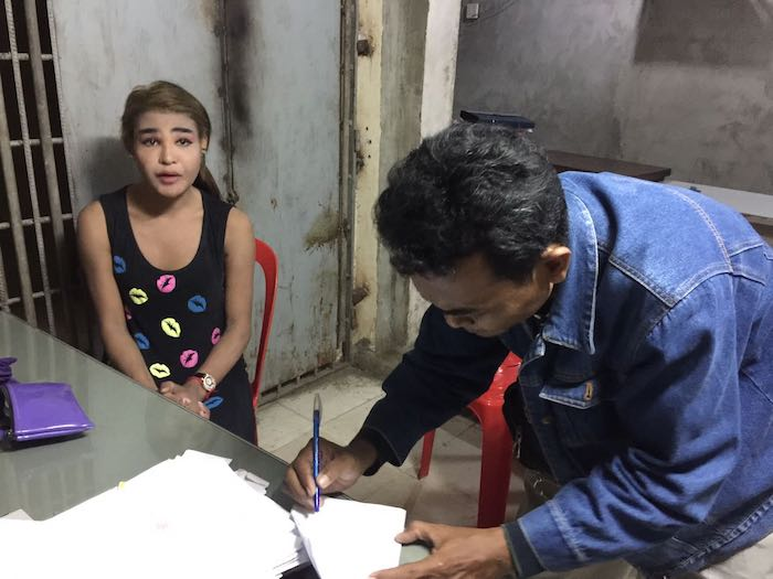 The ladyboy who stole his wallet speaks with police officers in Cambodia