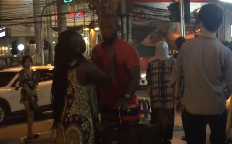 African wife catches husband flirting with ladyboys