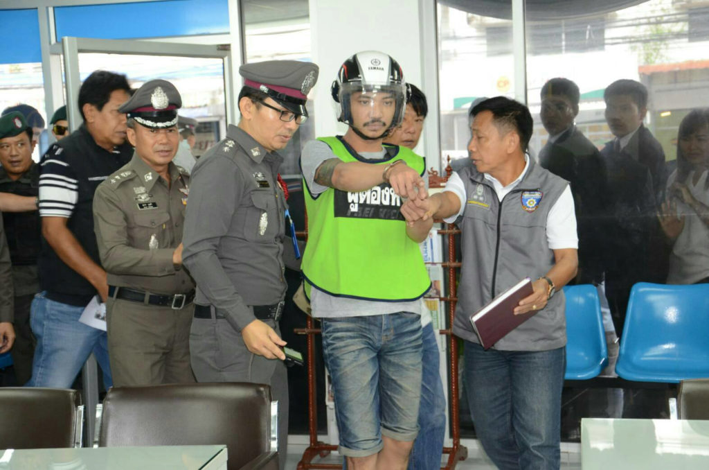 Badin Pungpee, 28, is made to re-enact the crime