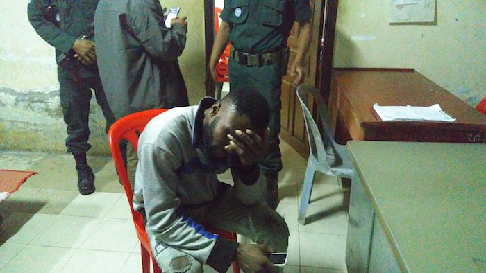 African tourist holds his head in his hands after getting mugged by four ladyboys in Cambodia