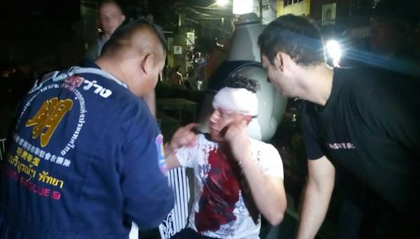 An Algerian tourist receives treatment after being attacked on Walking Street