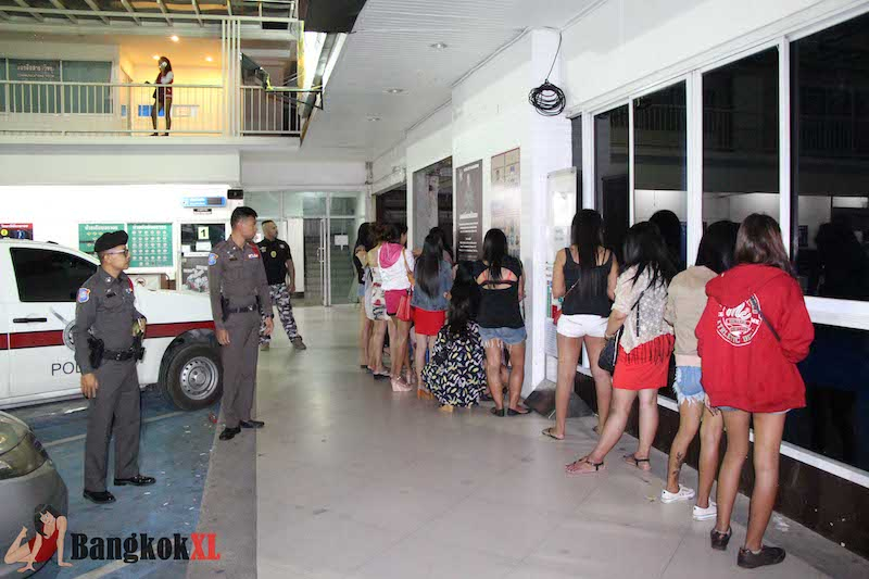 TWENTY-TWO THAI HOOKERS HAULED INTO POLICE TRUCKS